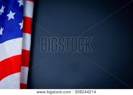 American Flag banner on dark background with room for text for 4th of July, Flag Day, Independence Day, Memorial Day