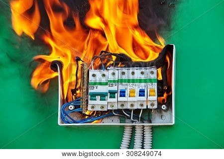 Bad Electrical Wiring System In Electrical Switchboard Became The Cause Of Fire. A Faulty Circuit Br