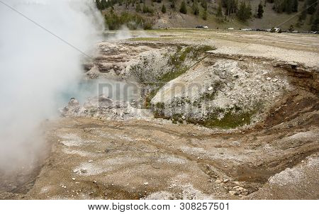 Geothermal Lakes And Steam In Yellowstone, Wyoming, Usa