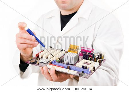 Computer Engineer examining/repairing a electronic circuit, isolated over white background