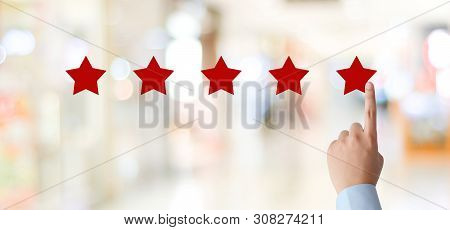 Man Hand Pointing Red Five Star Over Blur Background, Customer Excellent Rating Satisfacation, Custo