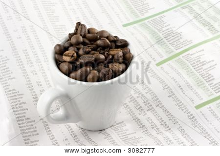 Espresso Cup On The Financial Pages