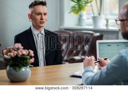 Alternative man attending job interview