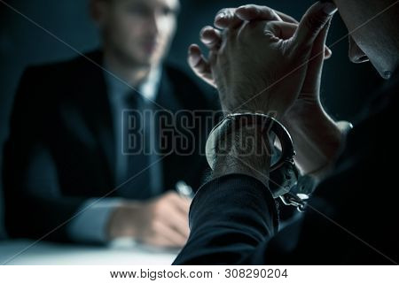 Criminal Man With Handcuffs In Interrogation Room Feeling Guilty After Committed A Crime