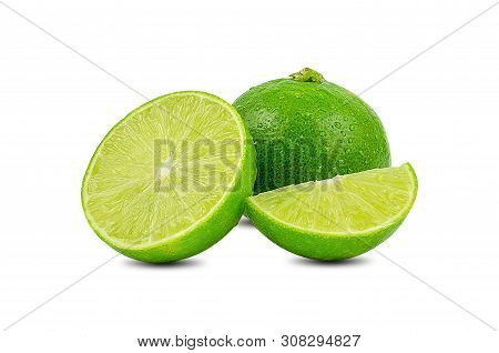 Natural Fresh Lime With Water Drops And Slice Of Green Lime Citrus Fruit Stand Isolated On White Bac