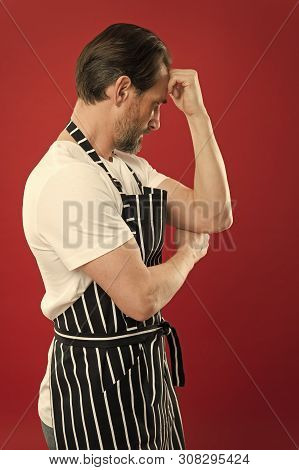 Confident Mature Handsome Man In Apron Red Background. He Might Be Baker Gardener Chef Or Cleaner. G
