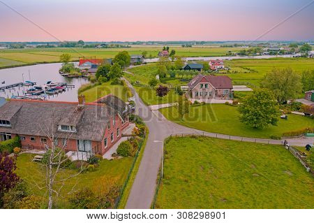 Aerial from the village Zevenhuizen in the countryside from the Netherlands at sunset