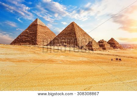 The Pyramids In The Sunny Desert Of Giza, Egypt