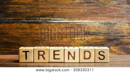 Wooden Blocks With The Word Trends. Main Trend Of Changing Something. Popular And Relevant Topics. N