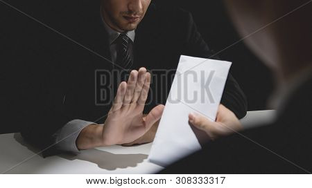 Businessman Rejecting Money In White Envelope Offered By His Partner In Shadow For Anti Bribery And