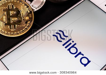 26 June 2019, Wuhan China: Libra The Facebook Cryptocurrency Logo On Mobile Phone Screen And Real Co