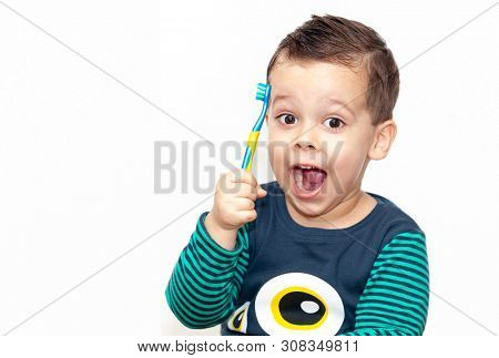 little kid brushing his teeth smiling happy isolated on white background
