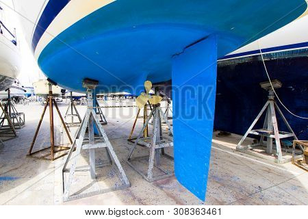 Boat With Blue Hull In Maintenance At The Shipyard