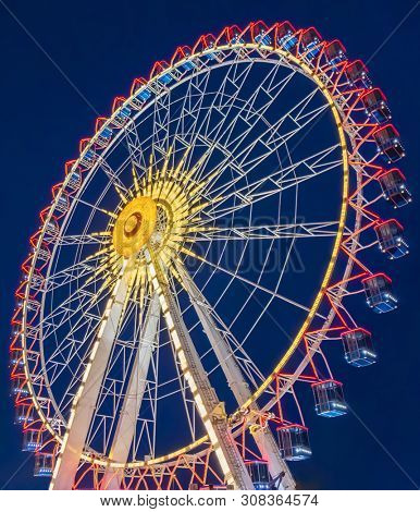 ferris wheel  at night in the summer