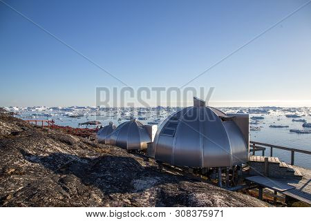 Ilulissat, Greenland - July 3, 2018: The Igloos At Hotel Arctic With View Over The Icefjord.