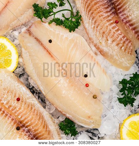 Whitefish Tilapia Fish Raw Fillet On Ice. Selective Focus.