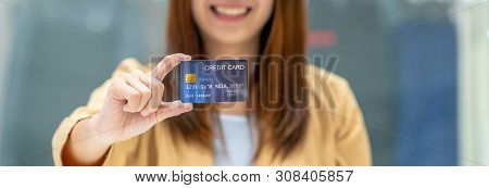 Banner Of Asian Woman Holding And Presenting The Credit Card For Online Shopping In Department Store