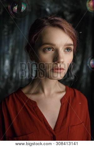 Attractive Sensual Young Caucasian Girl In Red Shirt With Deep Neckline, Open Clavicles, Pockets On