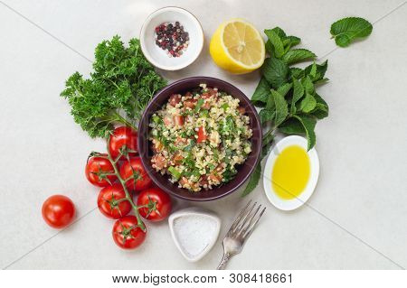 Lebanese traditional salad taboule soaked bulgur and ingredients poster