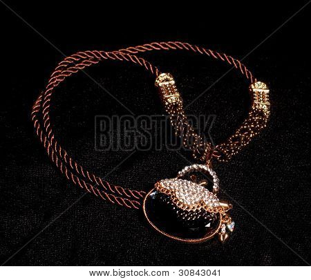 Gold jewelry on a black background located close up