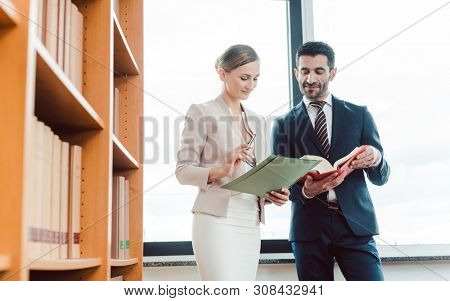 Turkish and central European lawyer in their law firm working in the library