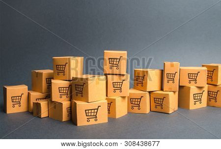 Many Cardboard Boxeswith Drawing Of Shopping Carts. Products, Goods, Warehouse, Stock. Commerce And
