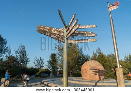 Tip Of Borneo - Borneo; May 29 2019; Sign Pionting To Major World Cities And Paces And Malaysian Fla