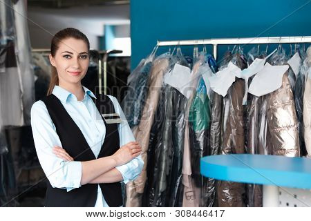 Portrait Of Young Female Worker In Dry-cleaning. Space For Text