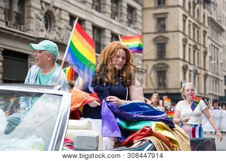 2018 JUNE 24 NEW YORK: NYC Pride March Stonewall Car driven by Willson Henderson with passengers Davey Leong and Nance Lomax, all National Stonewall Rebellion Veterans Association members.