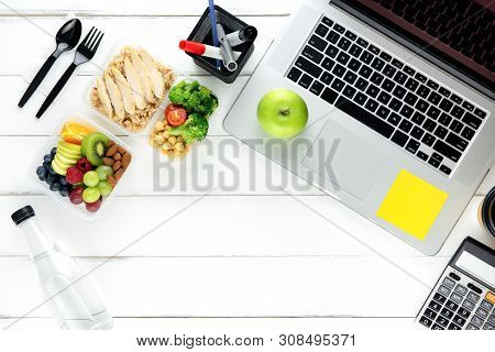 Clean Healthy Ready Ot Eat Low Fat Food In Meal Box Set Prepared For Lunch On Working Table With Lap