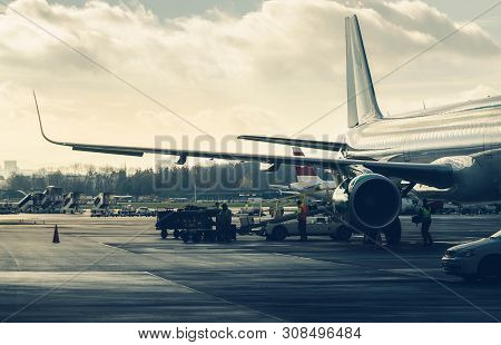 Airplane Preparation To Fly On Airport. Close Up Of A Airplane Preparation On Runway. Airplane Ready
