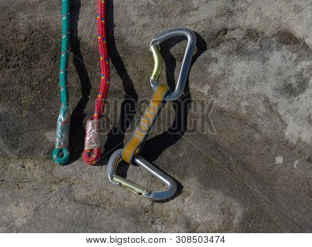 Hank Sling Carabiners At Used And Worn Red And Green Ropes. Old Used  Climbing Rope