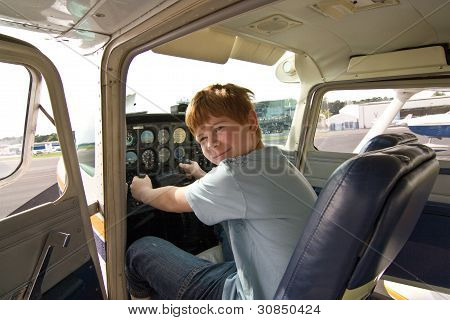 Joung Boy In The Pilot Seat At The Airport