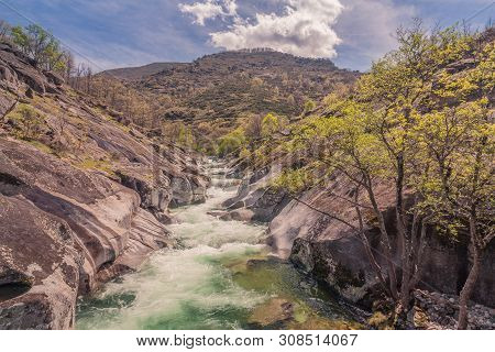 Valle Del Jerte, Caceres, Spain - April 7, 2014: Panoramic View Of A Torrent Between Rocks And Trees