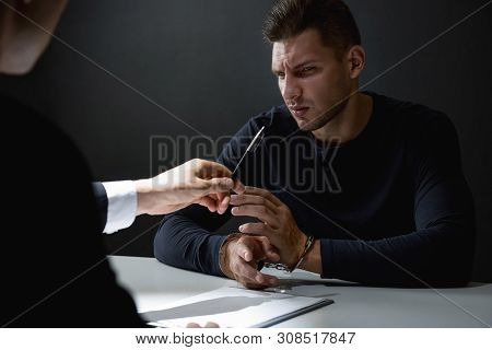 Criminal Man In Interrogation Room Being Interrogated And Refusing To Admit Crime