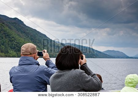 Tourists In Sight Of The Loch Ness Monster In Loch Ness, Scotland, Uk.