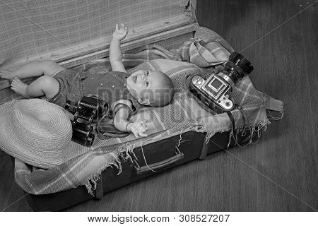 Positive Baby. Small Girl In Suitcase. Traveling And Adventure. Portrait Of Happy Little Child. Swee