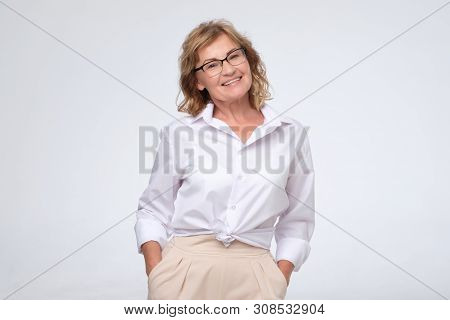 Positive Business Woman Of Middle Age Posing Over White With Arms Crossed, Copy Cpace