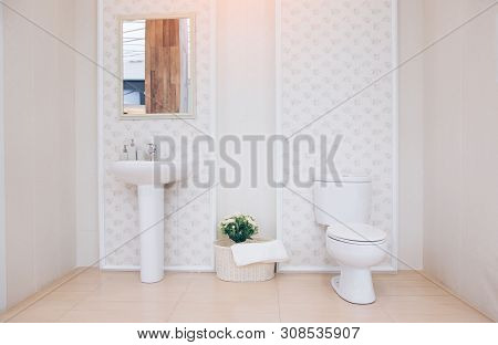 View Of A Spacious And Elegant Bathroom. Modern Spacious Bathroom With Bright Tiles With Toilet And