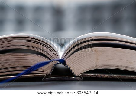 Reading Old Textbook In University Library, Read Book Or Relaxing In Vintage Black Background. Readi
