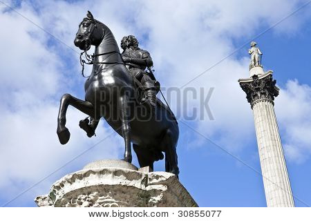 Charles I statue and Nelson's Column in Trafalgar Square. poster