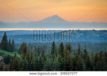 Mt. Redoubt Volcano On Sunset Sky Background, Alaska