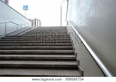 The Modern Exit From The Pedestrian Tunnel Is Empty, Up The Stairs. Staircase Up To The Street From