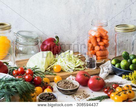 ?ooking Pickled Vegetables. Salting Various Vegetables In Glass Jars For Long-term Storage. Preserve