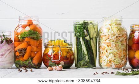 Pickled Vegetables. Salting Various Vegetables In Glass Jars For Long-term Storage. Preserves Vegeta