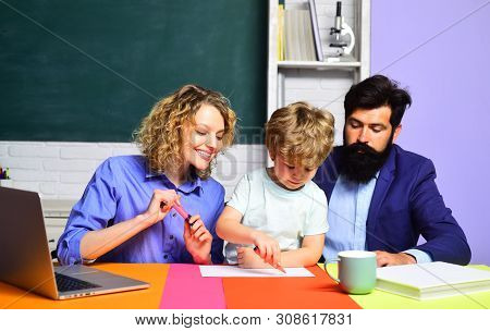 Educational Process. School Family. Happy Family. Boy From Elementary School. Mother Father And Son