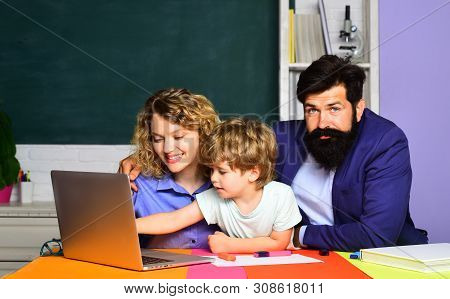 Boy From Elementary School. Mother Father And Son Together Schooling. Back To School And Home School
