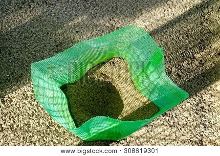 Plastic net for protection for sea turtle eggs on a beach on Rusukan Besar island,Labuan,Malaysia.To increase turtle populations,reburies the laid eggs in fenced hatcheries toprevent thefts of eggs. poster