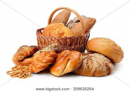 Fresh bread, buns and cookies in basket isolated on white background