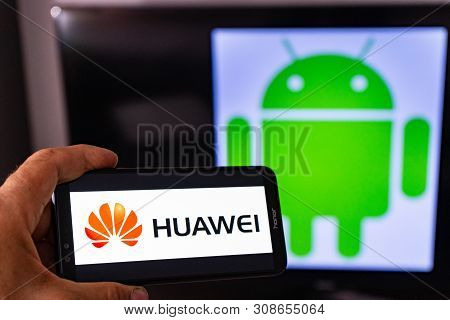 Magdeburg Germany - June 2019: A Man Holding An Android Smartphone Honor. On The Screen, The Huawei
